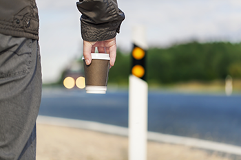 Commuter Carrying Coffee Cup Image